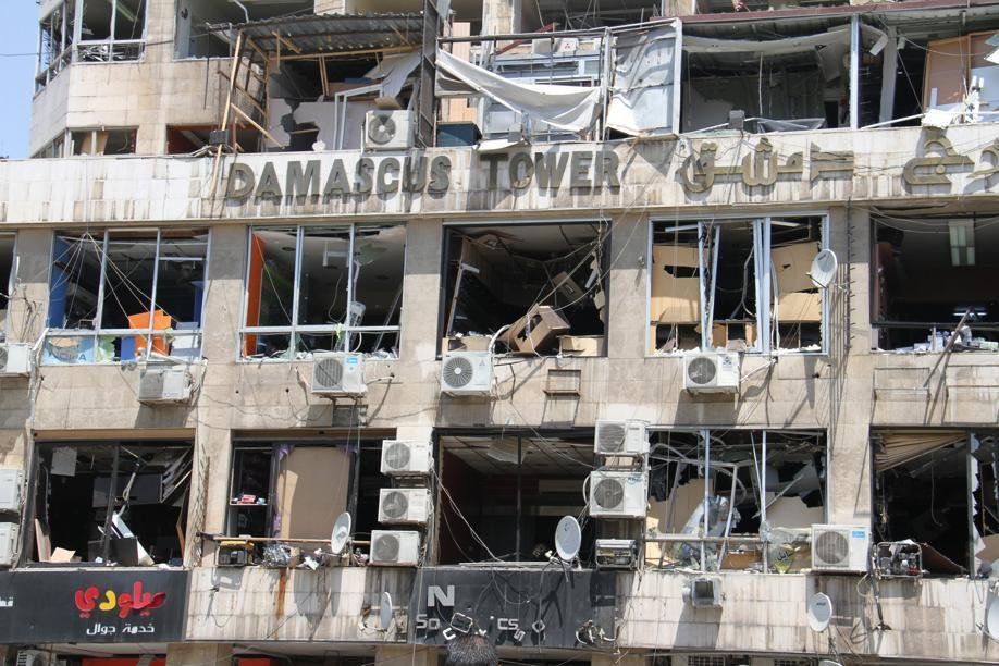 Damaged facades of commercial shops at the site an explosion in the heart of Damascus, Syria.